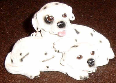 Two playing Dalmatian Puppies