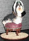 Shih Tzu auf einem Hocker / Sessel