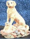 Sitzender Labrador mit Welpe